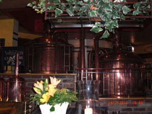 The copper vats displayed within the entrance to the Brauhaus Joh. Albrecht